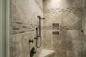 The tile of a walk in shower is cleaned and shined.
